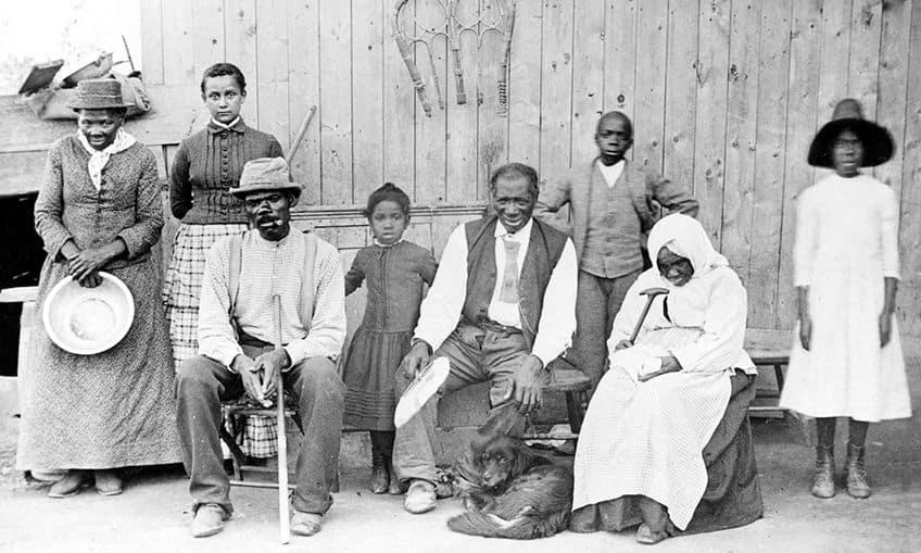 Harriet Tubman, on far-left, holding a pan.