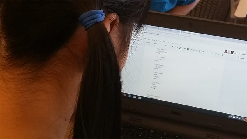 Over the shoulder glimpse at a computer screen.