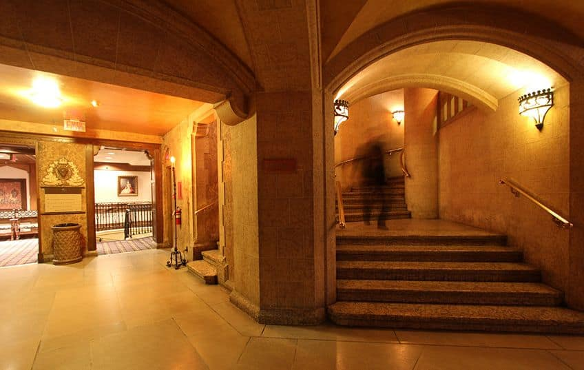 A blurry shot of a man walking inside the Fairmont Banff Springs Hotel in Alberta which people say is haunted
