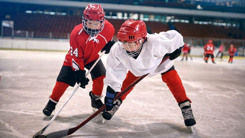 Kids playing hockey.