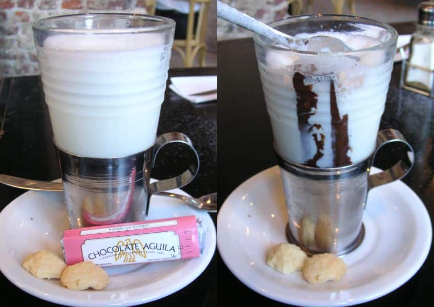 large cup of hot milk and chocolate bar