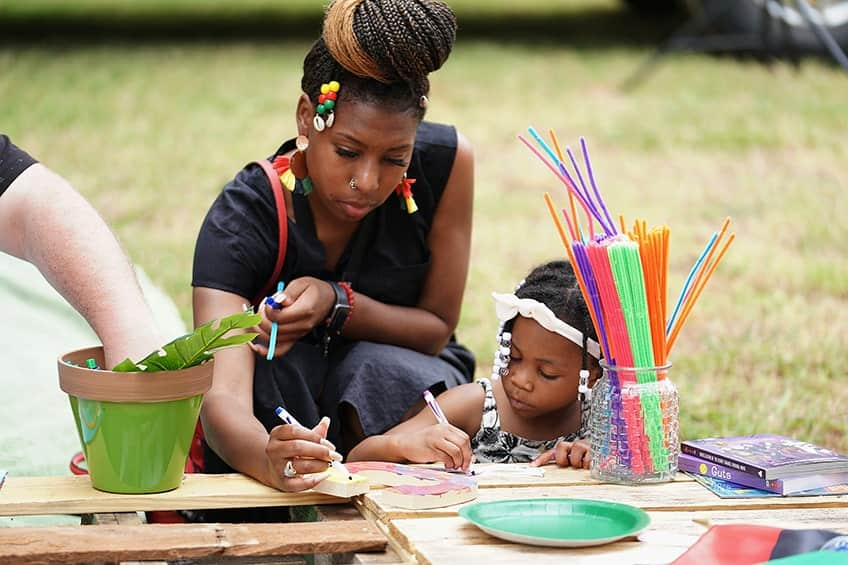 Mother and daughter at a craft station at a Juneteenth celebration in Oklahoma