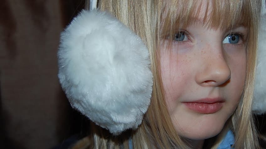 girl wearing fuzzy earmuffs