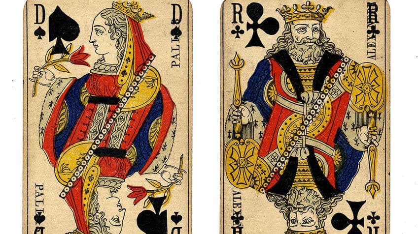 Old French cards featuring the Queen of Spades and the King of Clubs.