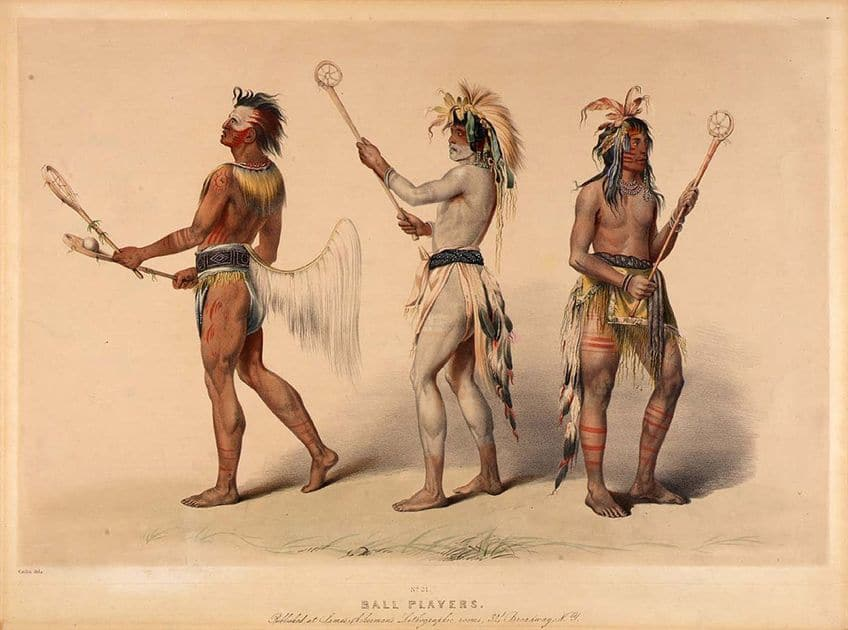 In a lithograph by artist George Catlin, he shows Indigenous lacrosse players holding sticks made of wood with sinew nets at the top.