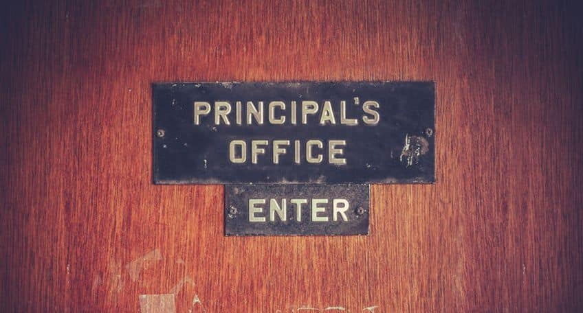 wooden door with a sign saying indicating it is the office of the school Principal