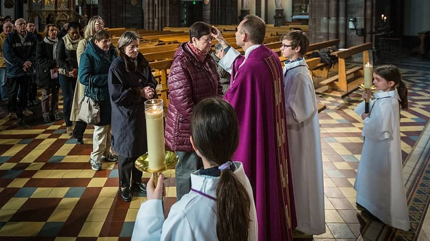 Worshippers in church lining up on Ash Wednesday