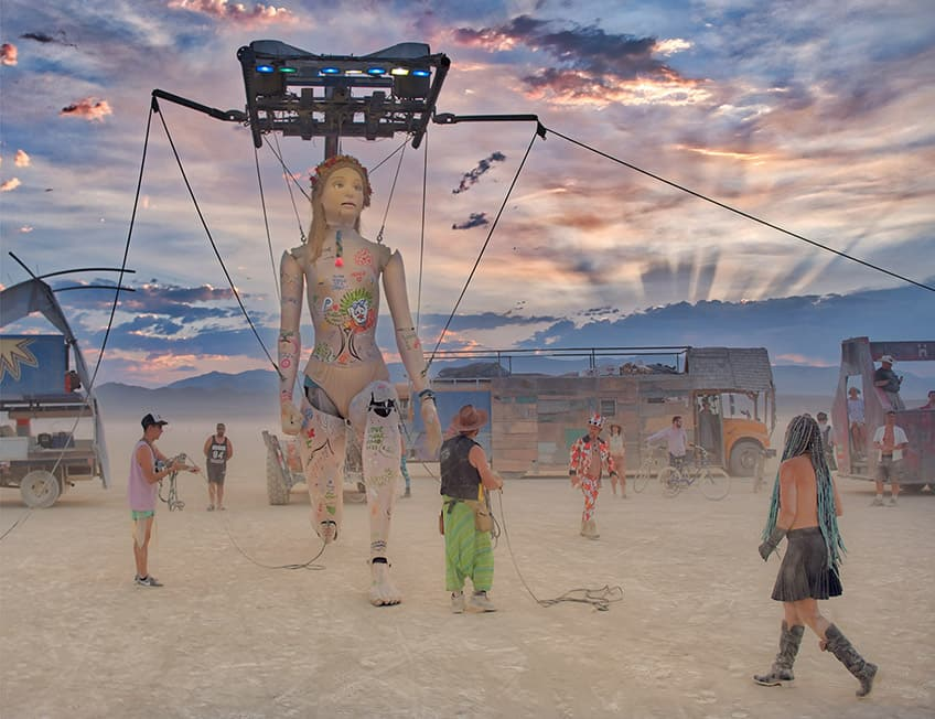 a gigantic marionette out in the desert at the Burning Man festival