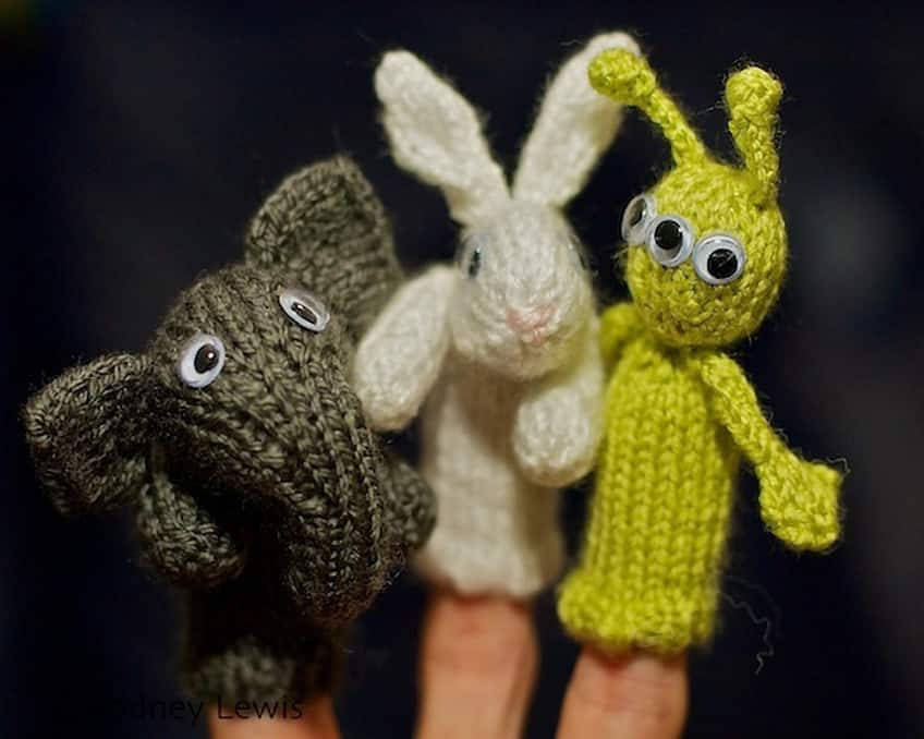 elephant and rabbit and alien finger puppets on a hand