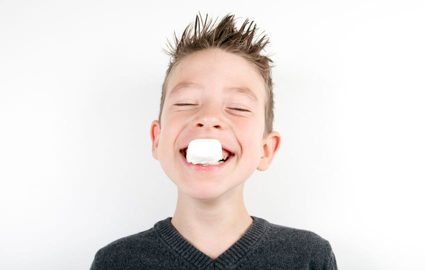 boy with a marshmallow in his mouth