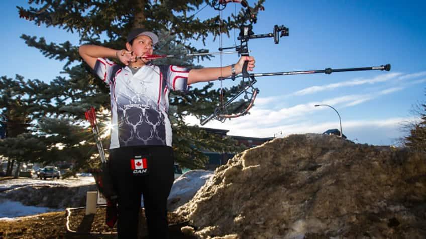Warren Collins of Alberta stands ready to shoot his arrow