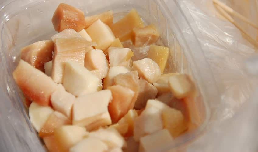 a bowl of fermented shark meat snack