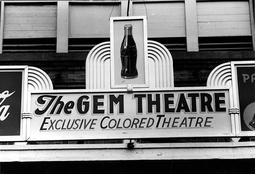 The marquee from the Gem Theatre says that it's an Exclusive Colored Theatre