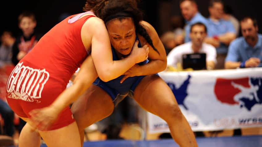 Female wrestlers in competition