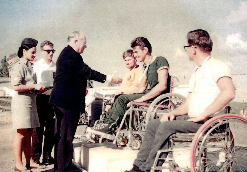 Dr. Guttmann with athletes