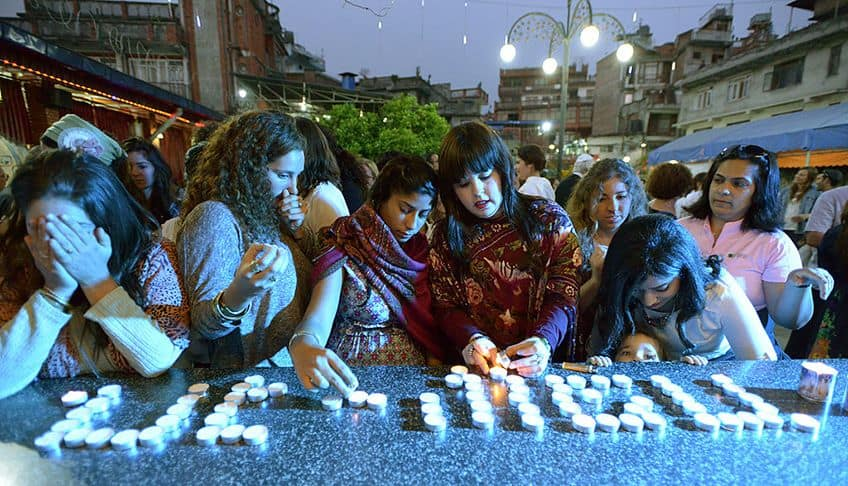 women light candles at a Seder in Nepal