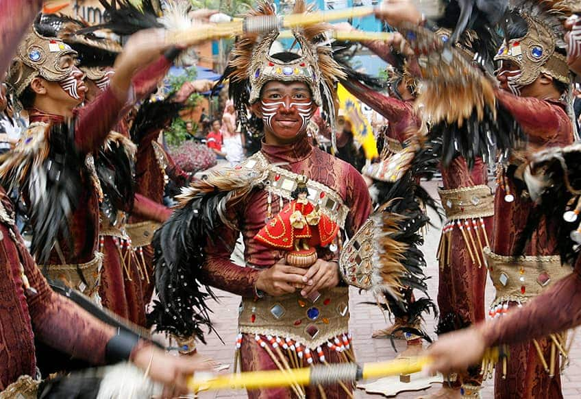 dancers dressed to look like they are wearing tribal costumes