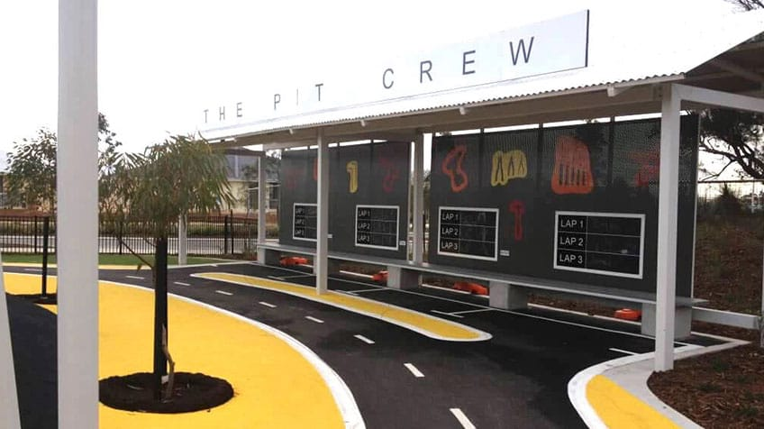 The Pit Crew bicycle playground with painted road lanes.