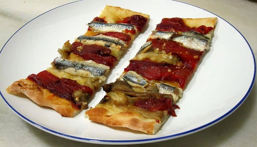 slices of coca pizza on a plate