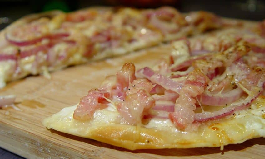 bacon pizza on a wooden board