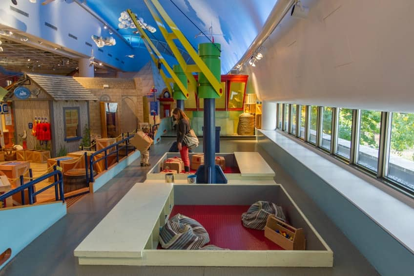 The museum's recreated port and cargo ship with a painted blue sky above and lots of boxes to play with