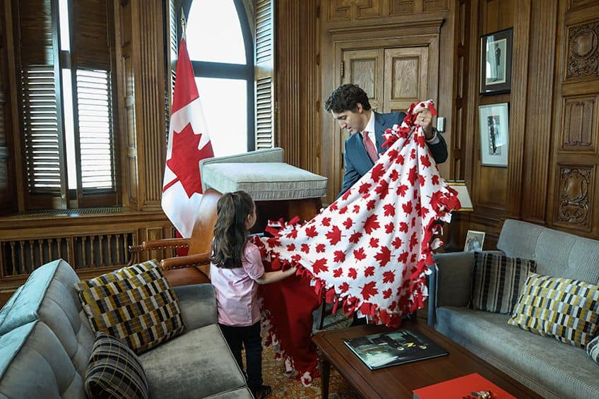 Bella and Prime Minister Justin Trudeau make a couch fort in his office in Ottawa