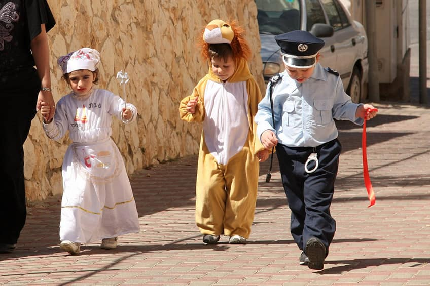 little children dressed up as a lion and a policeman