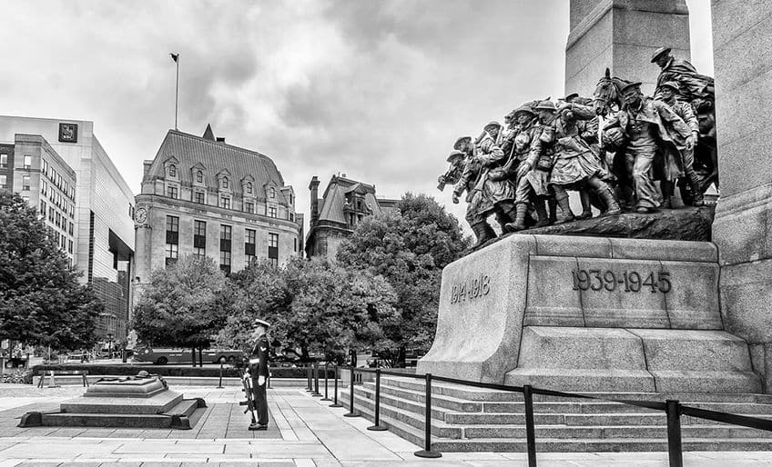 soldiers standing in front of the war memorial in Ottawa