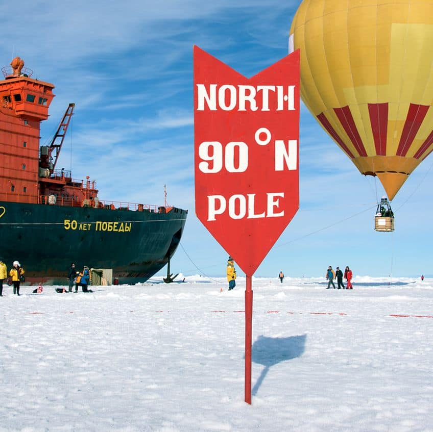 up at the north pole where the official marker for 90 degrees is located
