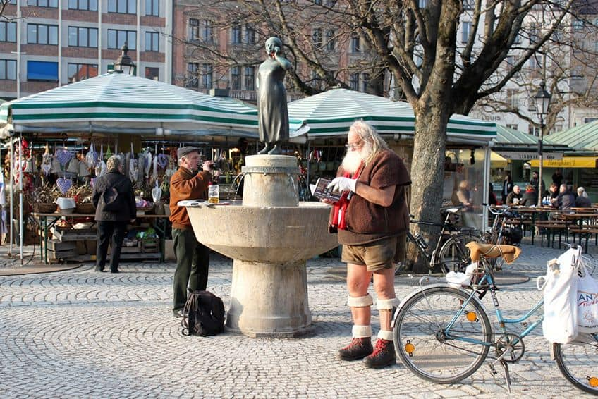 Santa standing in a plaza in Europe