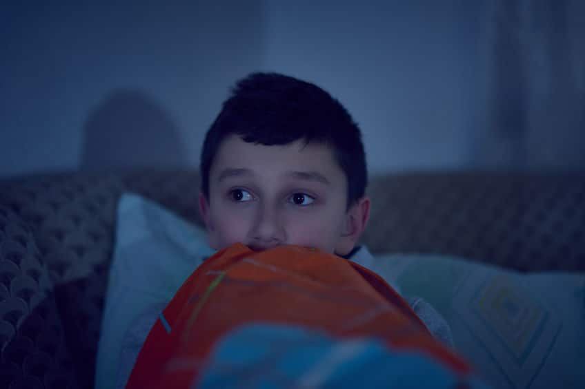 little boy watching scary show