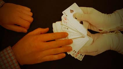 Hand spreads out deck of cards.