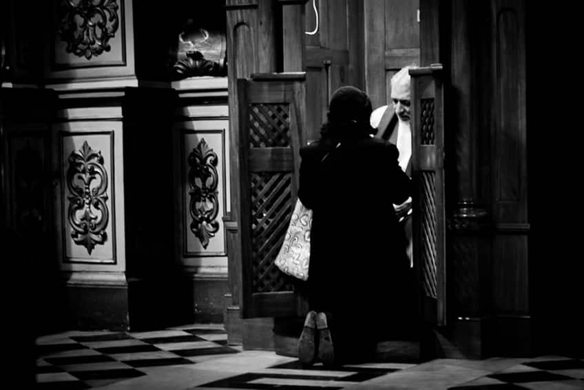 a woman at a confessional