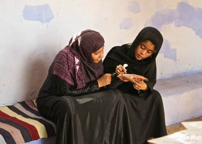 An Egyptian mother and daughter apply henna tattoos on Mother's Day which is during the spring equinox