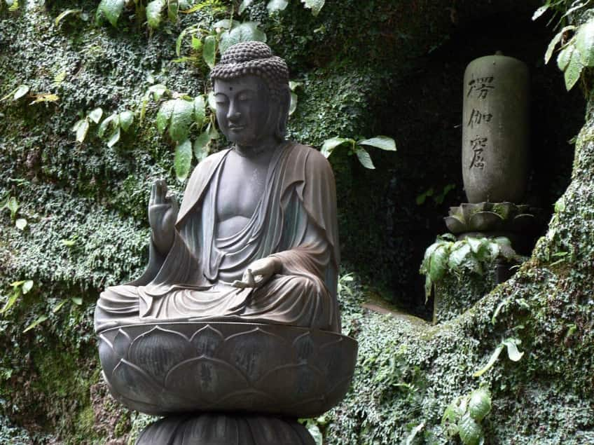 Japanese cemetery with a Buddha statue