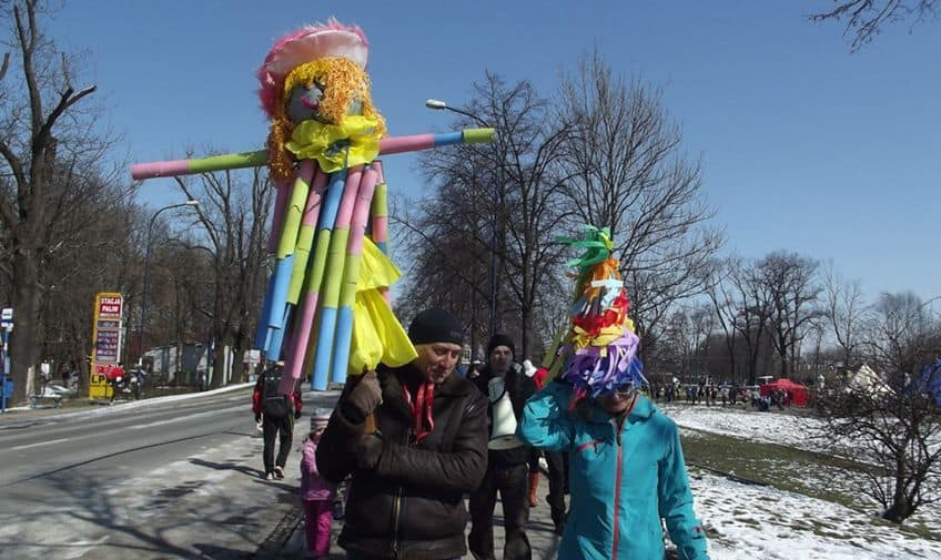 people carrying large paper dolls