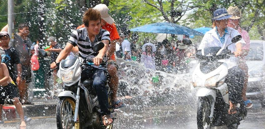 cyclists getting water thrown on them