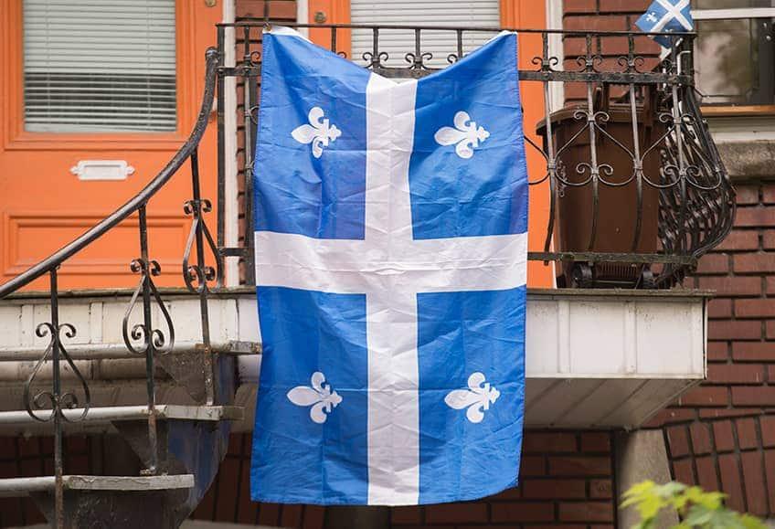 Quebec flag hanging off a metal balcony