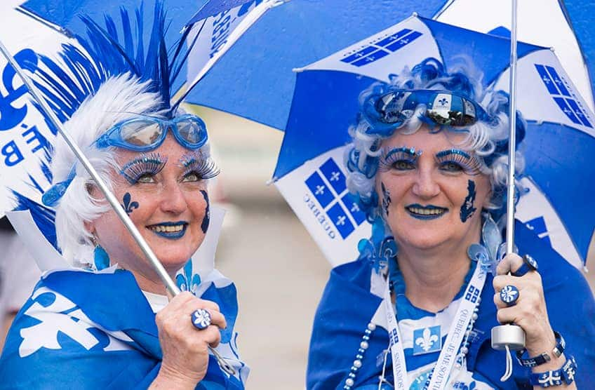 two ladies with blue and white face paint, hair and clothing