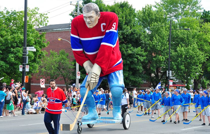 a giant statue of hockey great Maurice Richard in the parade