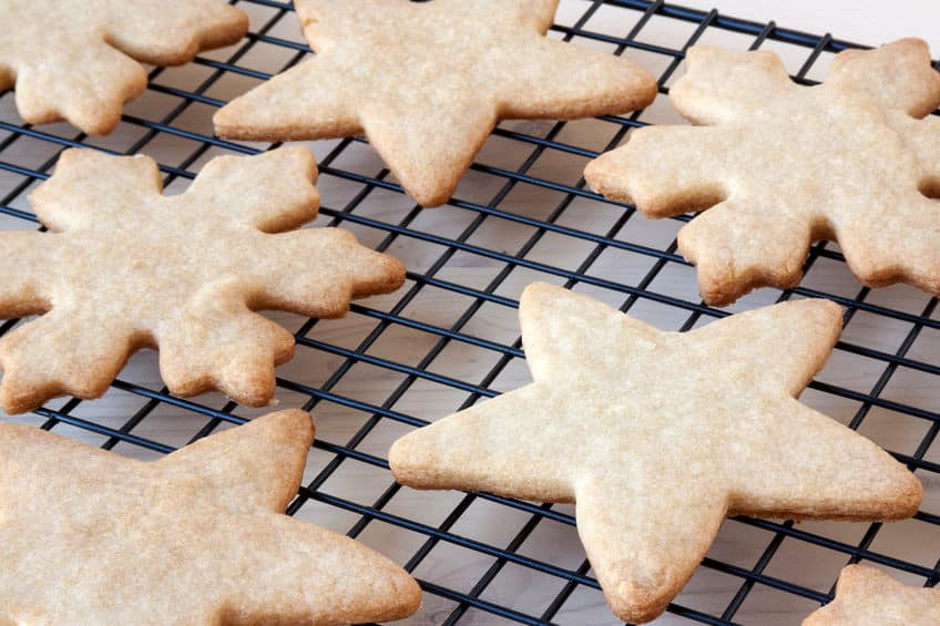 star shaped sugar cookies cooling on a rack
