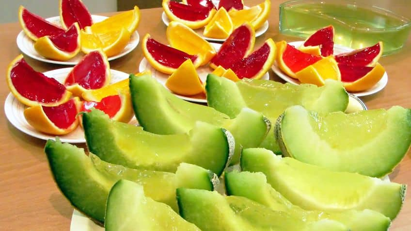 Sliced fruits on plates.