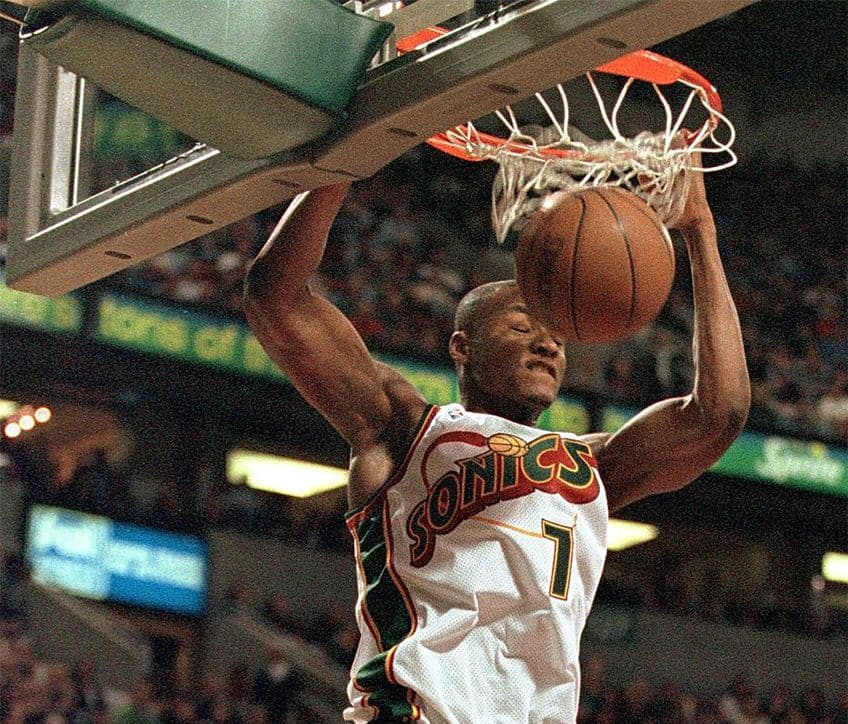 Seattle Supersonic rookie Rashard Lewis (top) slams home two points after an alley-oop pass from teammate Detlef Schrempf.