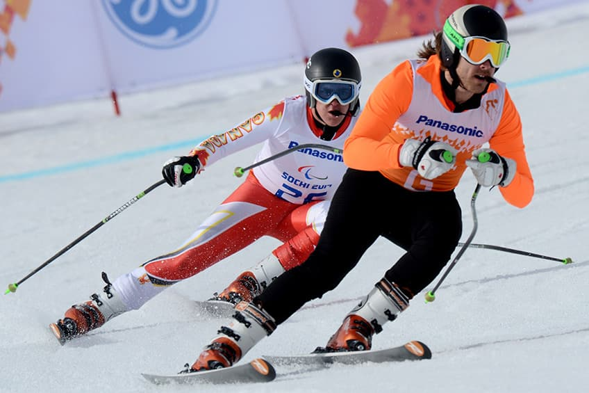 Mac Marcoux skis with his guide
