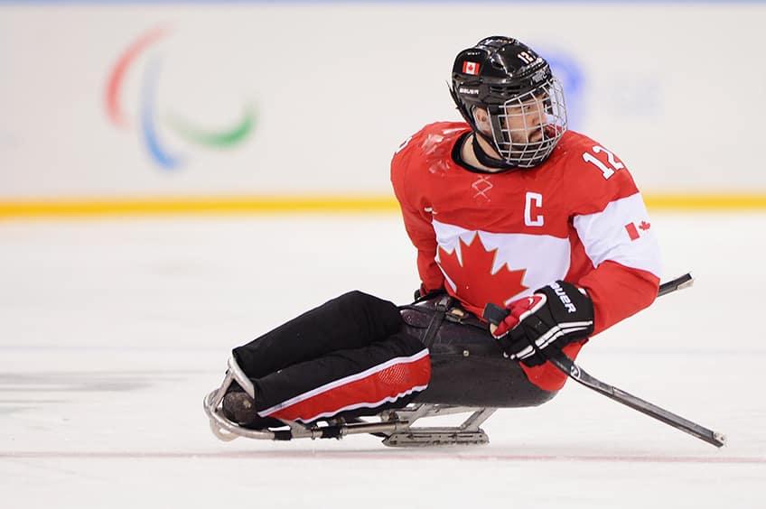 Greg Westlake in his sledge ice hockey getup in the hockey rink