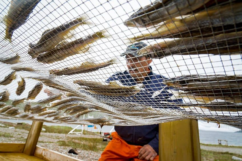man with dried fish