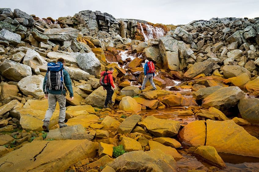 hiking over orange coloured stones