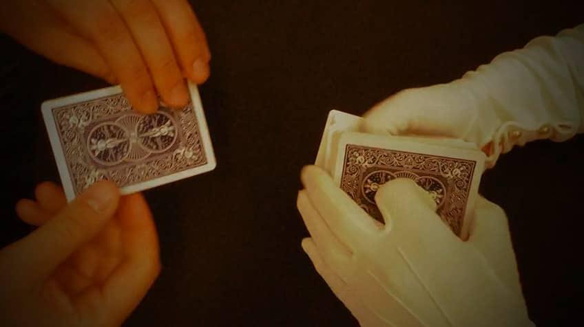Magician cuts deck.