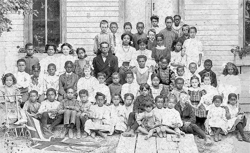 archival photo of students in front of the only school in Canada built by fugitive slaves