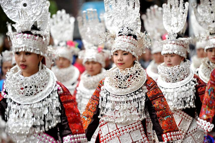 young girls dress in silver headdresses and local costume on Valentine's Day